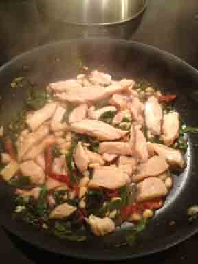 Chicken with Pasta and Beet Greens in the pan, ready to add the pasta