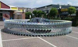 Car ring-fenced by shopping carts/trolleys