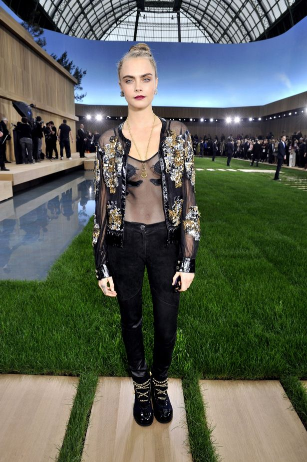 Cara Delevingne dares to go sheer, and brings pet pooch to the Chanel Couture show