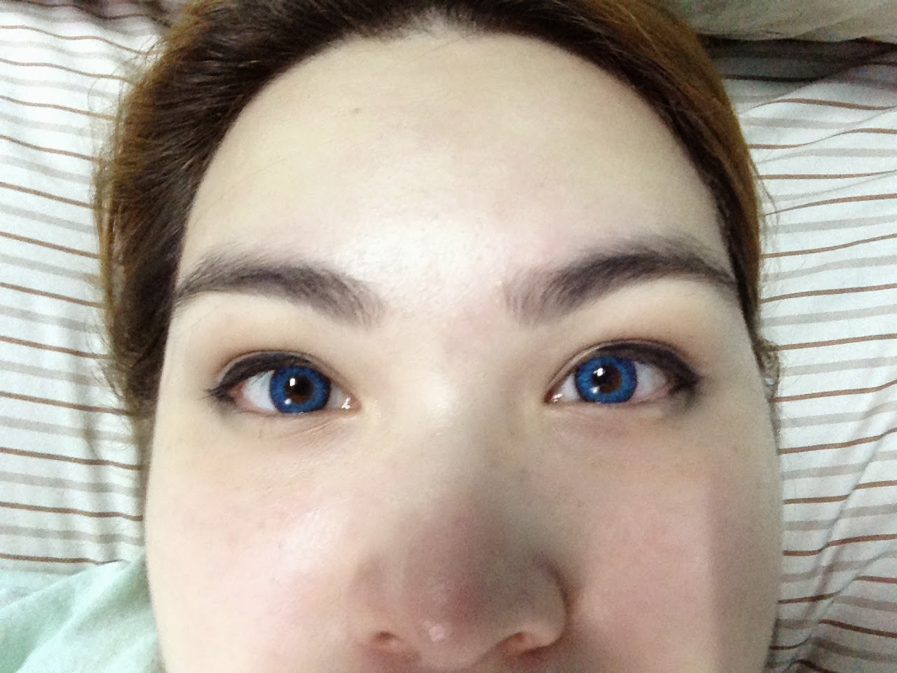 Sapphire blue contacts on brown