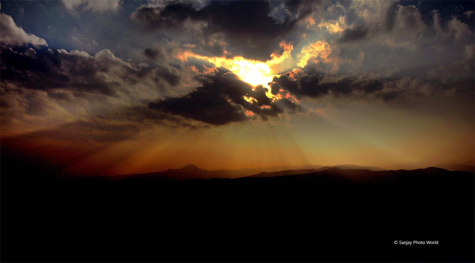sun inside clouds