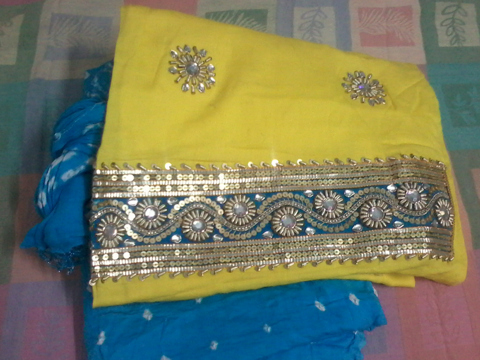How to create scrapbook on limeroad - Its A Beautiful Set Of Yellow Kurta With Blue Bandhej Salwar Cloth And Dupatta The Kurta Has Kundan Flower Patches All Over And The Border Of Kurta Has