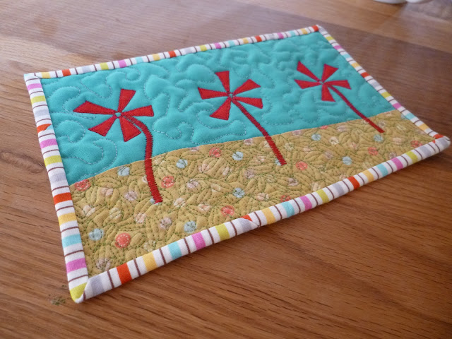 Experimenting with applique and free motion quilting on small projects like mug rugs