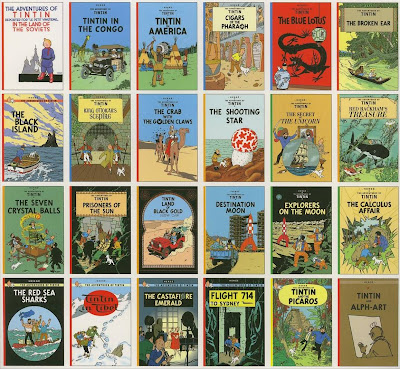 24 Tintin books laid side-by-side