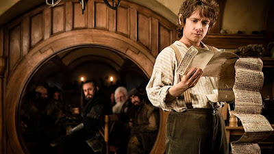 Martin Freeman as Bilbo Baggins in The Hobbit: An Unexpected Journey, as dwarves look on, directed by Peter Jackson