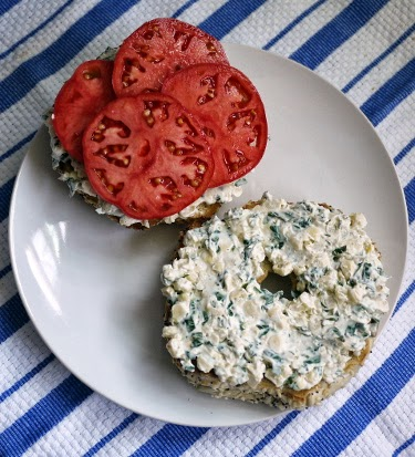 corn basil schmear on everything bagel with caspian pink tomato