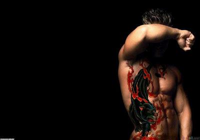 cool dragon fire tattoo on man