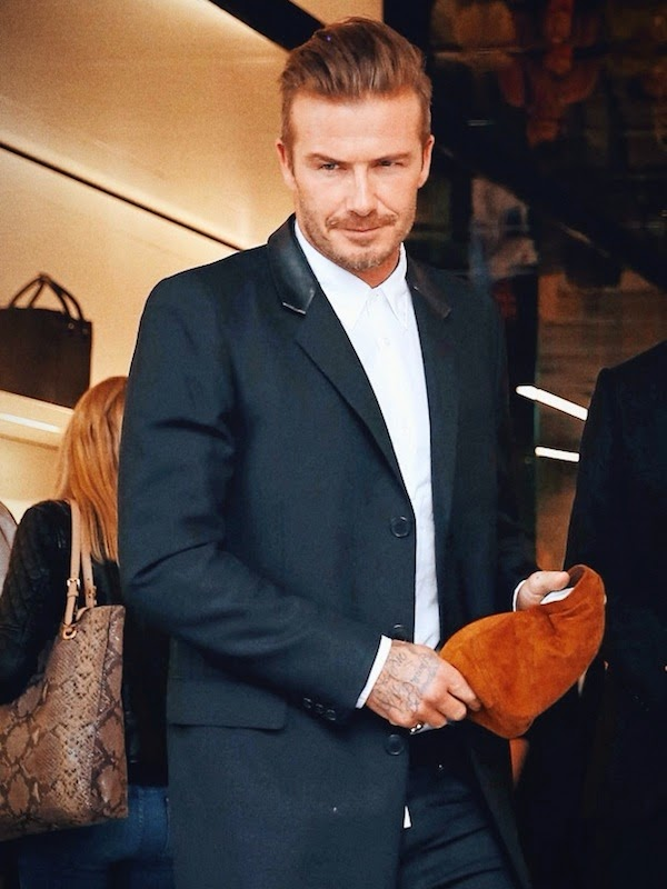 David Beckham wears Saint Laurent by Hedi Slimane leather collar coat at Victoria Beckham store opening September 2014