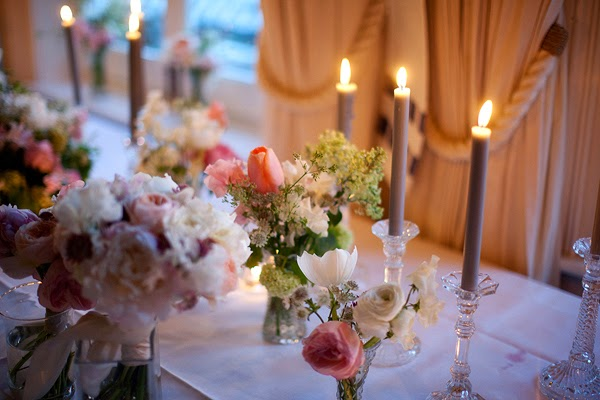 Wedding at London Rowing Club on the Thames.Candles and pink flowers