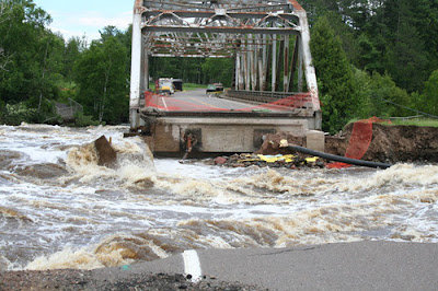 Duluth_flood_photos_St_Louis_river_washed_out_bridge_between_Thomson_carlton_recent_natural_disasters