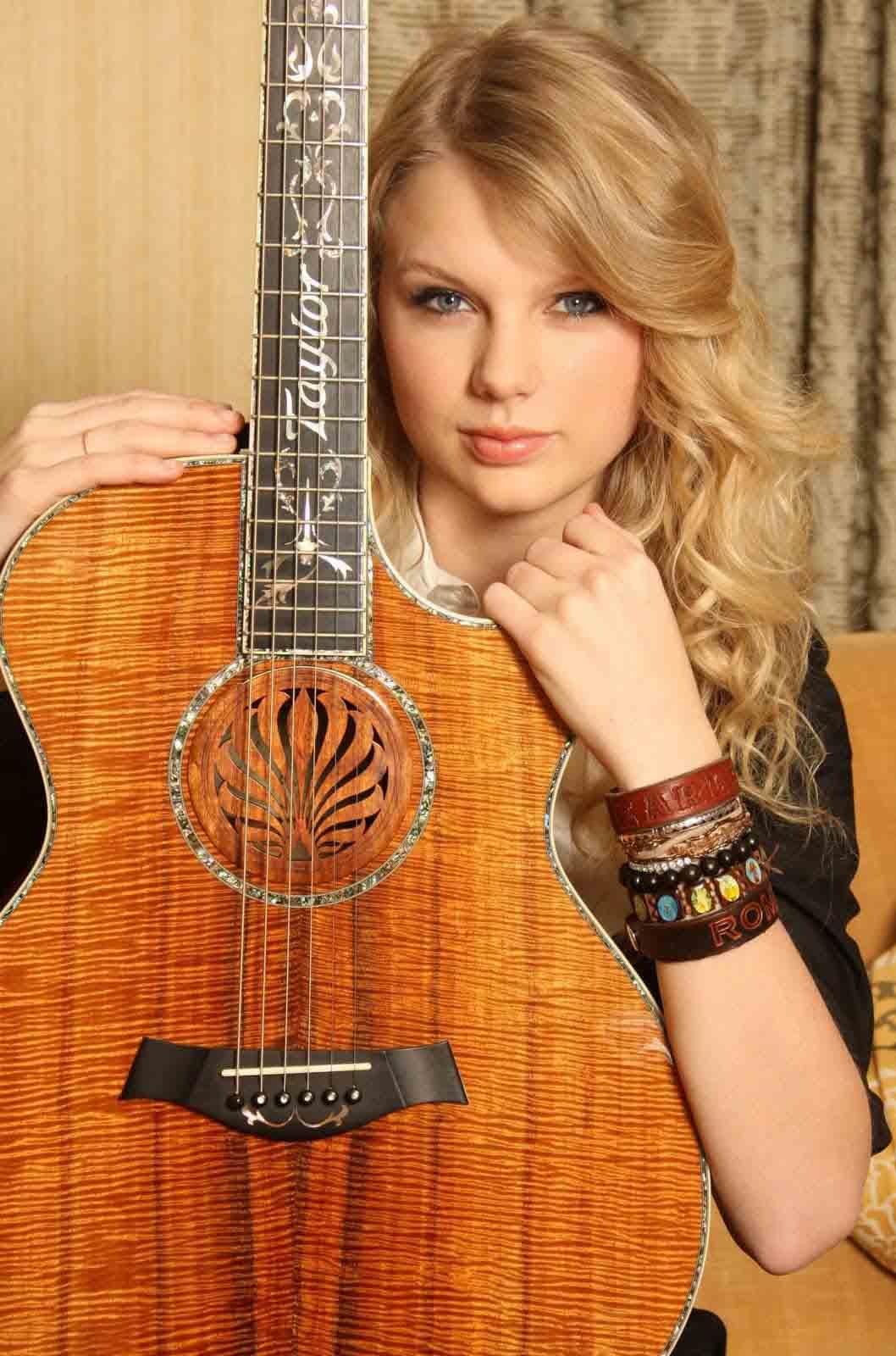 http://4.bp.blogspot.com/-nePnAa0Xvfs/UIVjv9jqO0I/AAAAAAAABKk/-UE6NZphf_w/s1600/18694_taylor+swift+with+guitar+copy.jpg