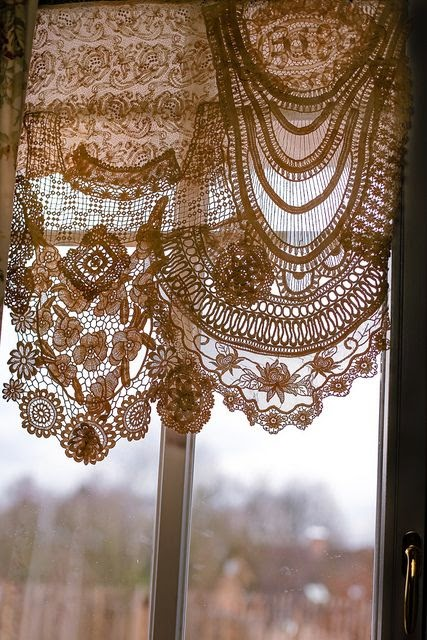 lace curtains made from joining a variety of laces trims and delicate