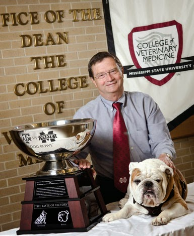 Dr. Kent H. Hoblet, dean of the Mississippi State University College of Veterinary Medicine, poses with the Dog Bowl Trophy, which is part of a competition with the Texas A&M University College of Veterinary Medicine & Biomedical Sciences. (Courtesy of MSU CVM)  ​