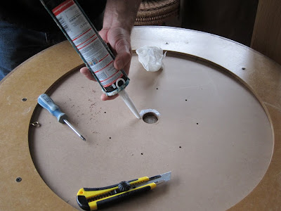 Crokinole - Applying the glue to the reverse of the inner board for the central well cap