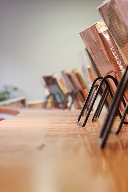 receding row of library books on book stands