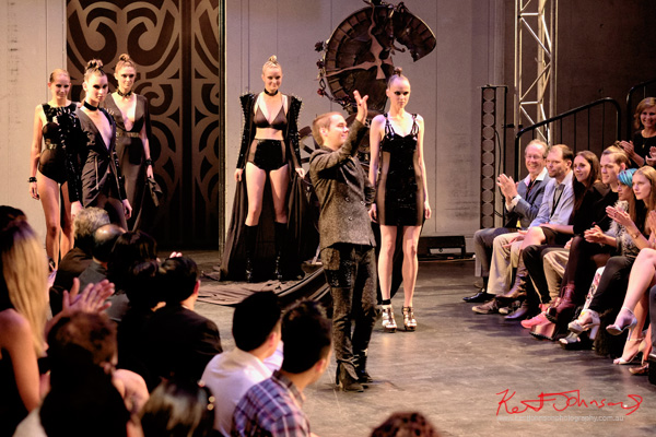 Designer Will Brunton takes a bow on the runway with his models, Gothic Erotic, Raffles Graduate show 2012.