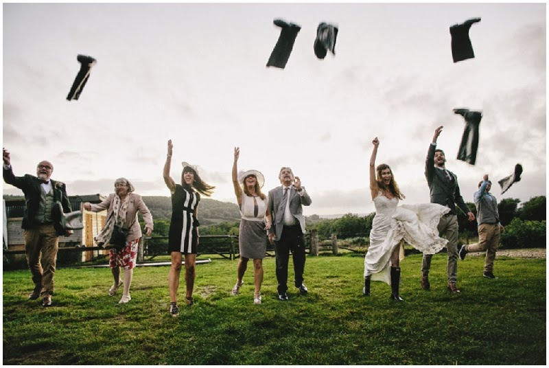 Bridal party welly wanging at a farm wedding
