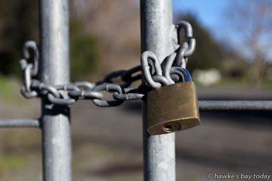 Padlock and chain on a farm gate, orchard, rural gate, Springfield Rd, Waiohiki, Napier - for burglary, burglaries, security series photograph
