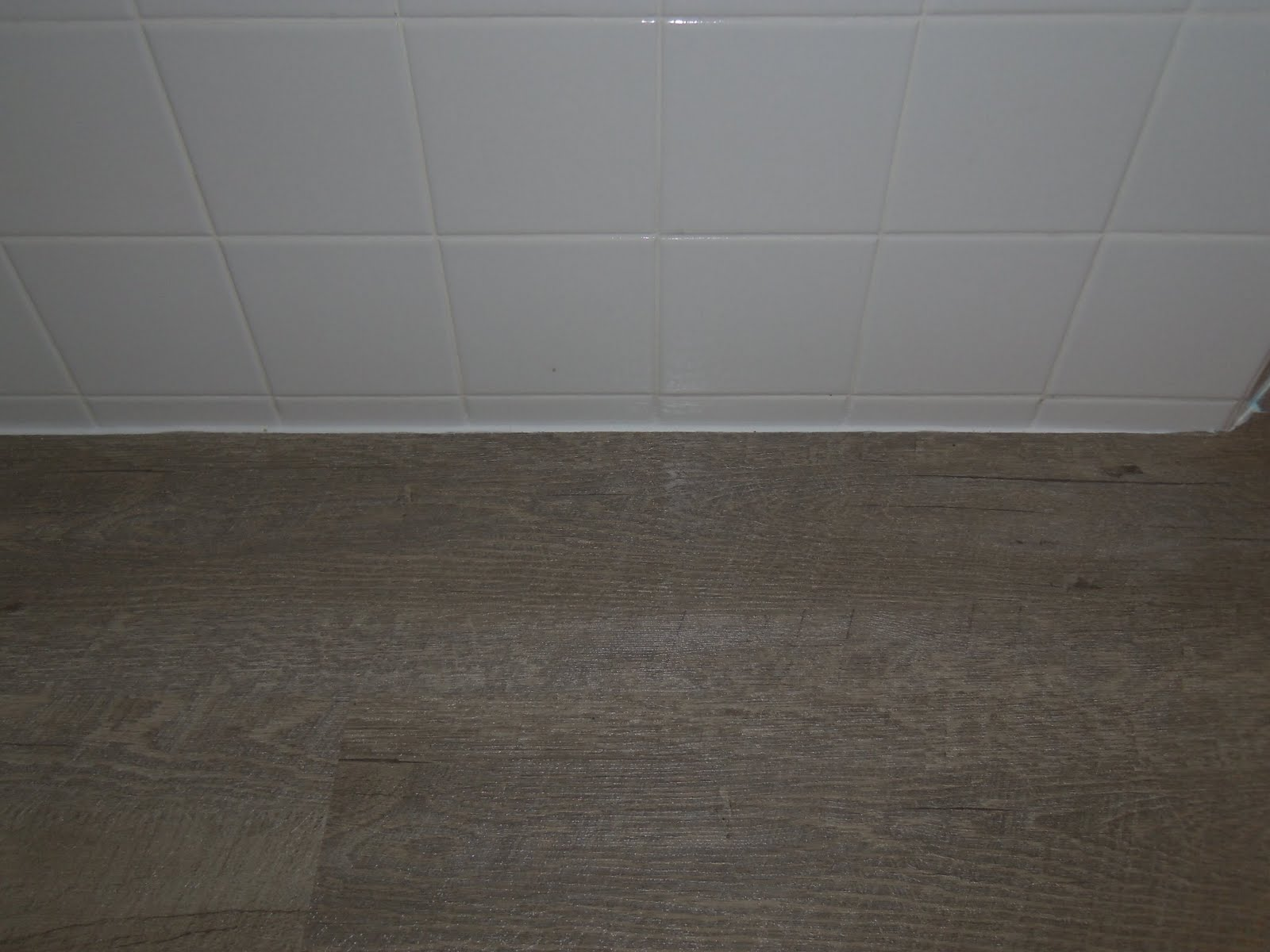 Simply cottage love installing allure ultra flooring diy caulk around bathtubs and areas without quarter round this will keep your floor water tight doublecrazyfo Image collections