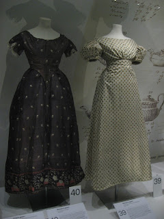 1820s fashions. The gown on the left is a purple silk gauze.