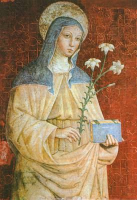 santa Clara con lirios y un libro en las manos