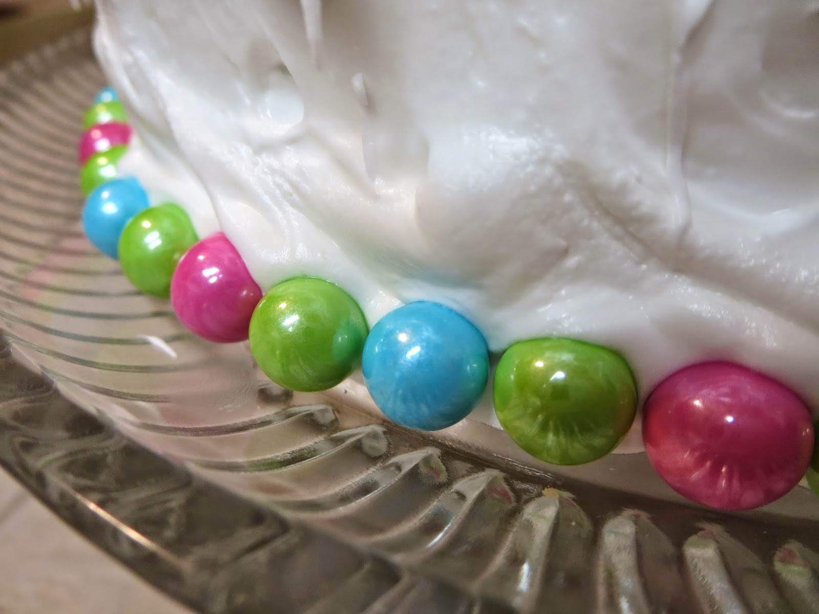 Baby Gender Reveal Cake - Close Up of Sixlets Base