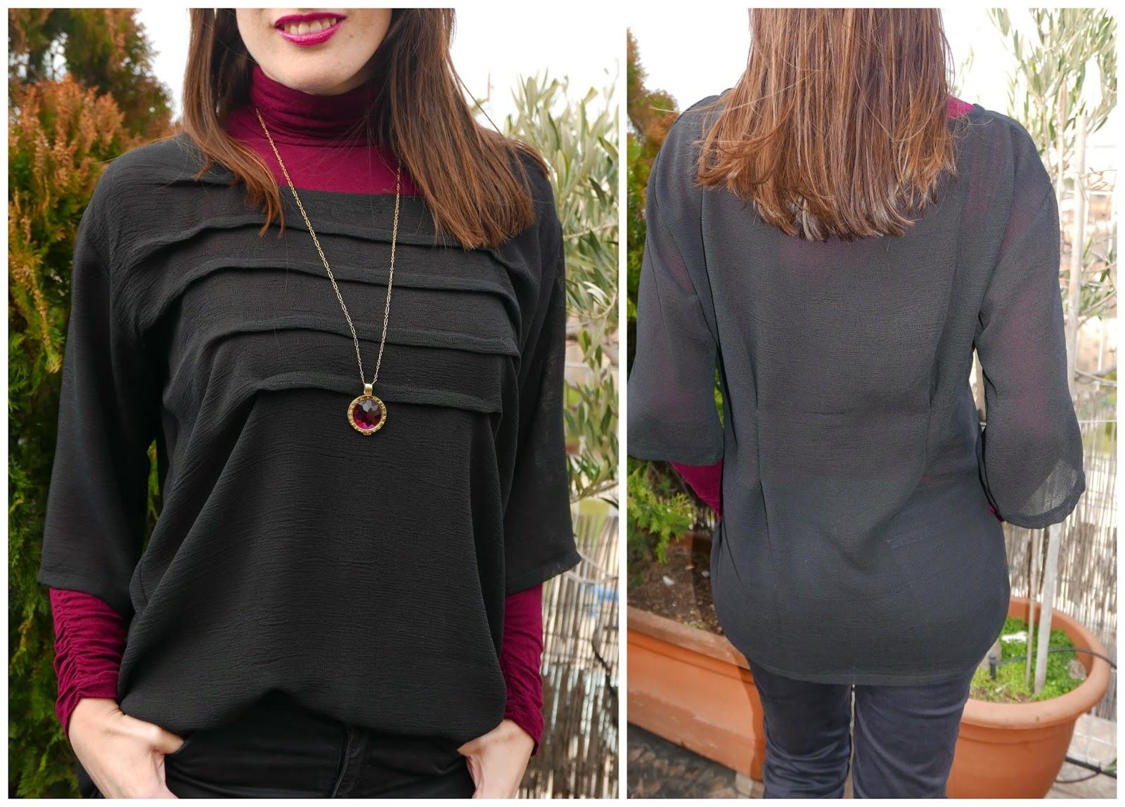 Blusa negra con pliegues y línea oversize para vestir a capas