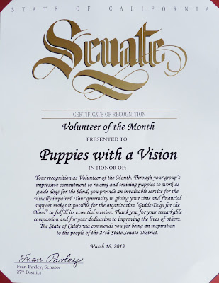 Puppies with a Vision certificate of recognition from State Senator Fran Pavley