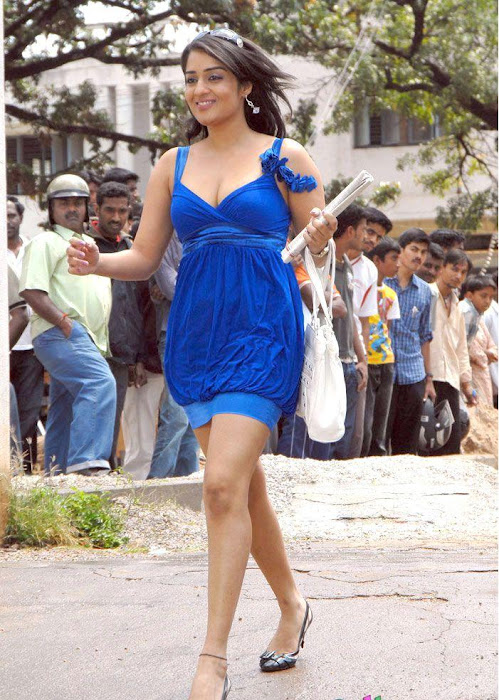 Nikitha in Blue Short Skirt Dress showing her thighs carrying a Handbag pics
