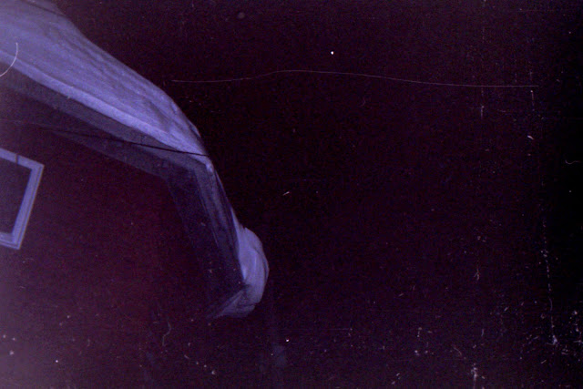disposable camera, bad exposure, winter, snowfall, snow, winter night, snow in the eaves, snow on the roof