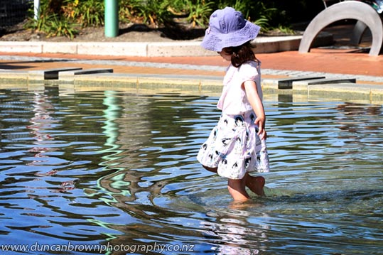 Little girl in water feature, Hastings CBD photograph