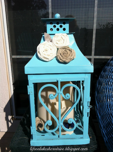 "alt=""lantern makeover using kryon spray paint fabric rosettes"""