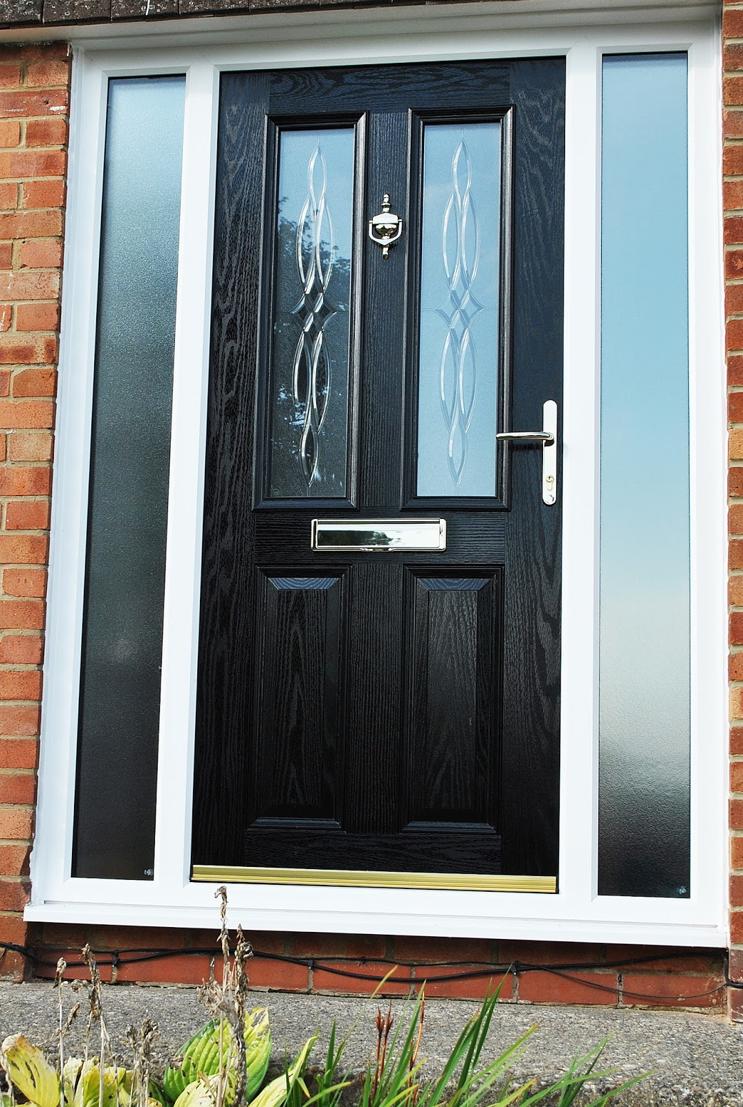 A recent installation modern black composite door with