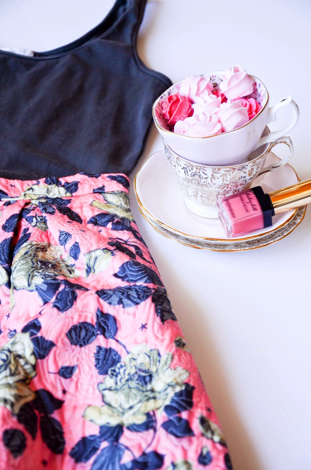 vintage pink and gold tea cups with pink sugrared roses, YSL baby doll kiss and blush, pink and gray floral midi skirt from forever21