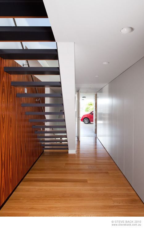 Hallway with staircase in the River House by MCK Architects