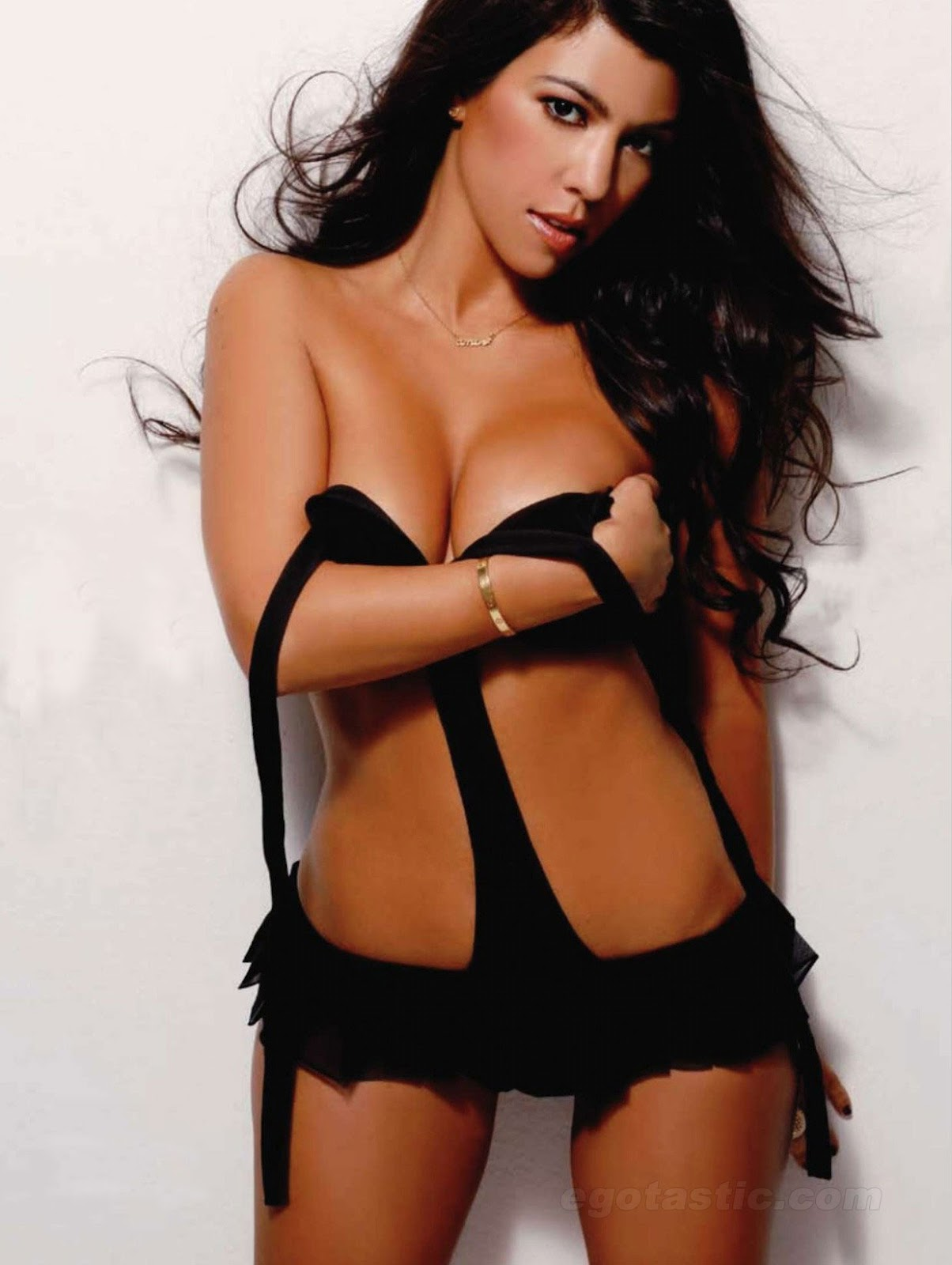 KOURTNEY KARDASHIAN HOLDING BOOBS MAXIM
