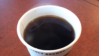 steaming cup of black coffee