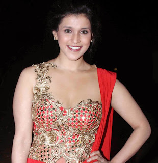 Mannara Chopra in Beautiful Red Sleeveless Choli and red gown at a Fashion Show