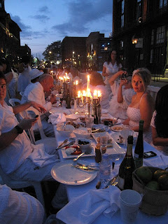 People dine by candelight in the Distillery District