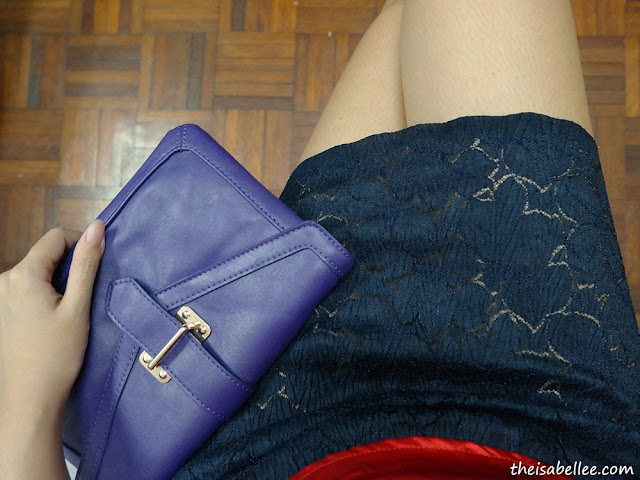 Lace skirt and blue bag