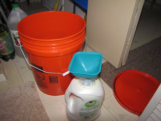 I put my batch in this 5 gallon bucket and it fills it right up. I then use my Pampered Chef Flexible Funnel to pour it into the old detergent container.