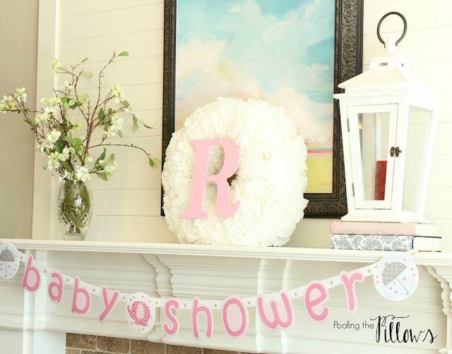 Monogram wreath on the mantel for a baby girl shower at Poofing the Pillows.