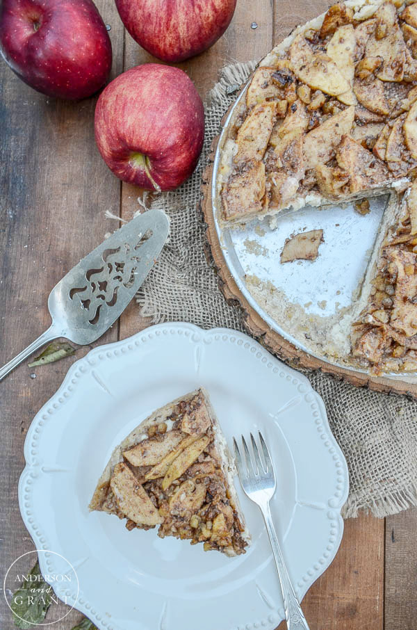 Apples and walnuts are added to the top of this delicious cheesecake.  |  www.andersonandgrant.com