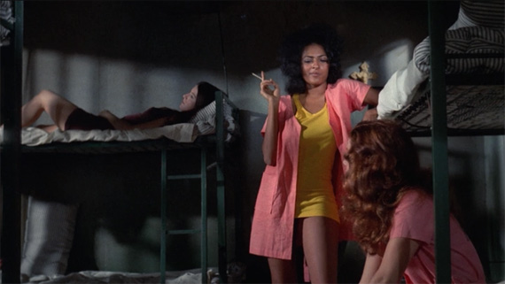 Pam Grier and prisoners in The Big Doll House