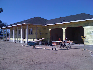 The house wrap is applied over the assembled wall panels