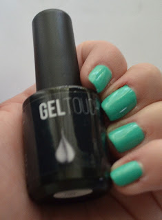 Models own turquoise gel manicure