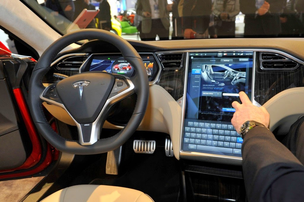 Apple to buy Tesla