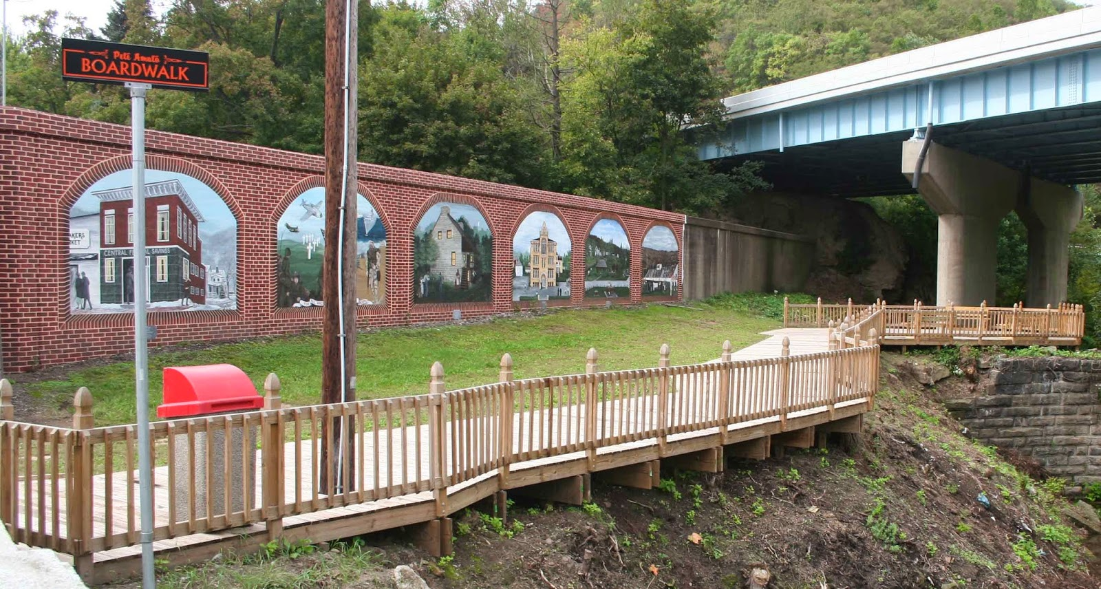 our national calamity the great easter 1913 flood june 2014 one section of the wellsville ohio floodwall murals by gina hampson are graced with a small park hampson has painted the concrete floodwall to look like
