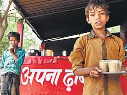 small boy working at tea stall
