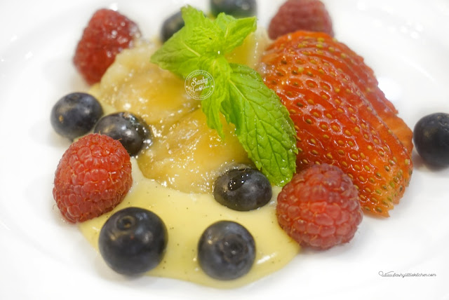 Madagascan Vanilla Bean Pudding, fresh berries and caramelized bananas